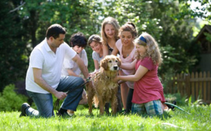 family-playing-with-pet-dog